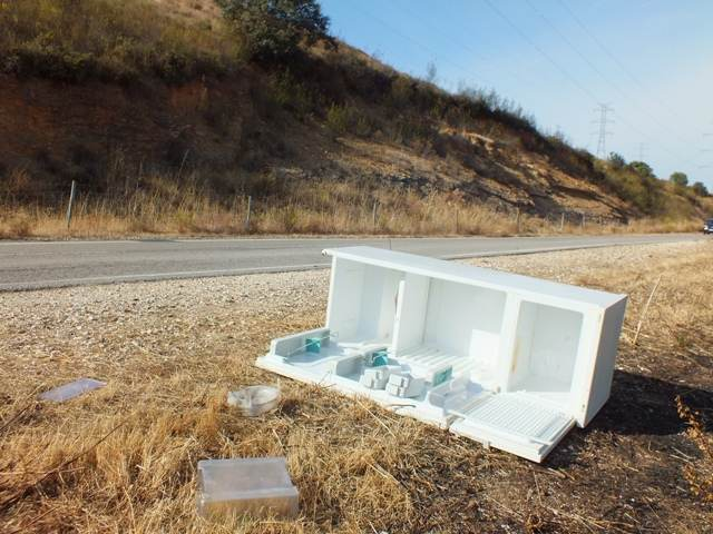 A freezer dumped on the side of the road near a tourist attraction